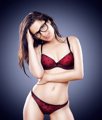 sexy hipster girl with glasses in lingerie