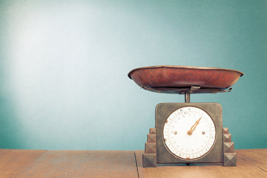 Retro old kitchen weight measurement balance on table