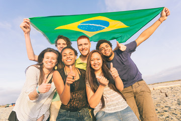 Group of Friends with Brazilian Flag at Beach