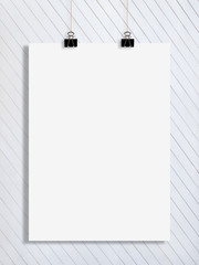 a white list of paper on the white wooden wall