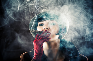 beautiful glamorous woman in retro style with cigar