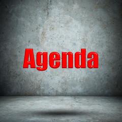Agenda on concrete wall