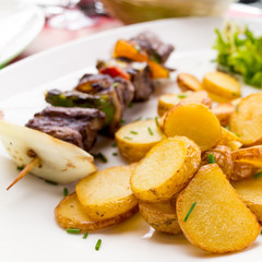 tasty grilled meat and vegetables skewers