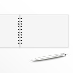 Blank notebook with pen.