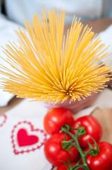 Hands holding Spaghetti