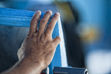 Hand of old man on a fishing  boat