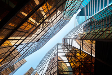 Upwards perspective of glass commercial skyscrapers, Hong Kong