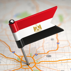 Egypt Small Flag on a Map Background.
