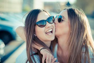 two beautiful young women having fun