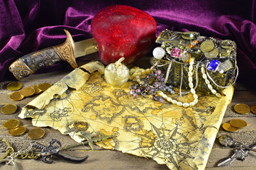 Pirate treasures with knife and map