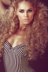 Young girl with long curly blond hair.