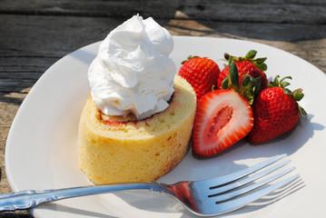 Cream on Vanilla Cake with Fresh Strawberries