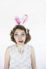 Woman in rabbit ears making face