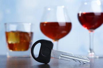 Composition with car key and glasses of drinks,
