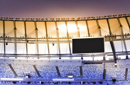 Empty stadium with electronic billboard