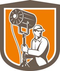 Electrical Lighting Technician With Spotlight Shield