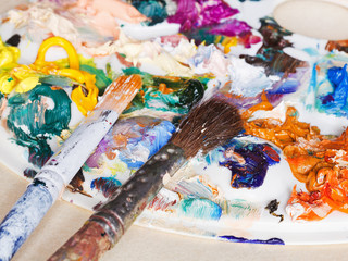 paint brushes and used artistic palette