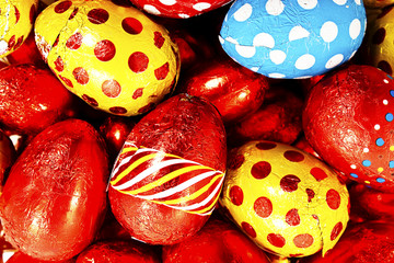 Colorful candy Easter eggs wrapped in foil