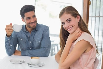 Portrait of a smiling couple at coffee shop