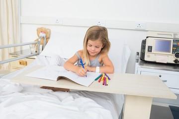 Sick girl coloring book in hospital