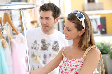 Attractive young woman doing shopping in tourist area