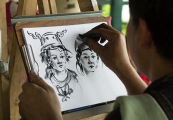 artist paints portrait of two children