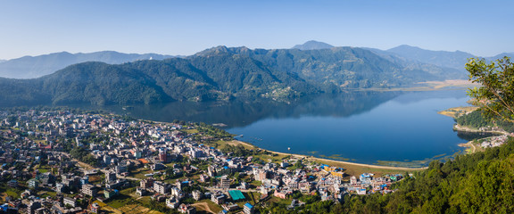 View over the popular tourist city of Pokhara and the Phewa Lake