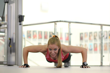 Young woman working out in a gym
