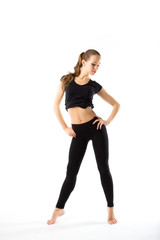 Young woman doing aerobics and stretching, isolated on white bac