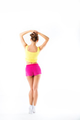 Young woman fitness. Full length from back in sportswear on a wh