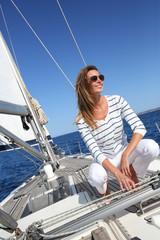 Spoed Foto op Canvas Zeilen Attractive modern woman enjoying sailing cruise