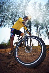 Wall Murals Cycling young man riding mountain bike mtb in jungle track use for sport