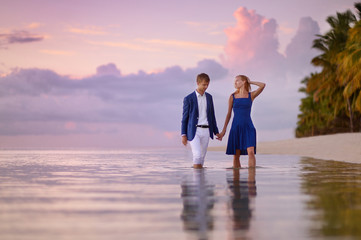 Beautiful romantic couple on a tropical beach