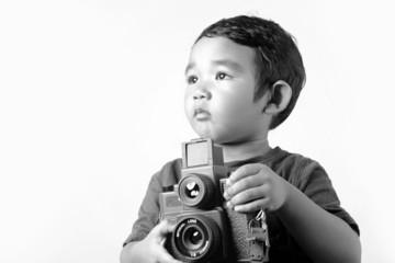 Baby holding film camera
