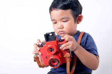Baby boy holding camera