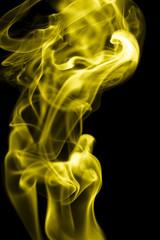 yellow smoke on a black background