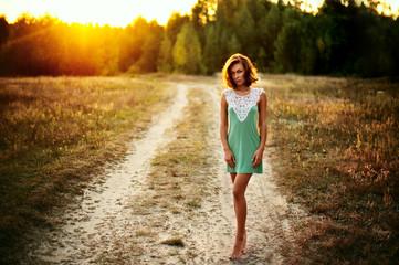 Beautiful girl at sunset