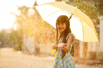 Pretty young asian girl in the rain