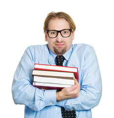 Nerdy shy, young guy, student with glasses holding books