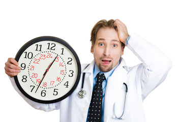 Running out of time. Stressed, busy male doctor