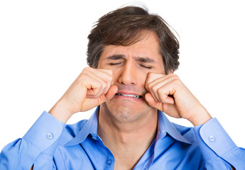 Crybaby, mature man acting out making cry faces, white backgroun