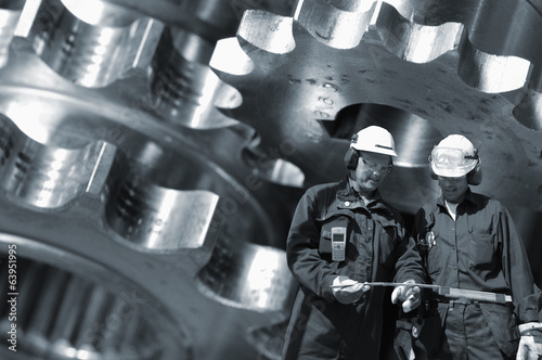 Wall mural engineers working with giant gears machinery