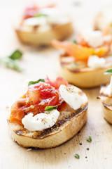 Tomatoes, oregano and feta crostini