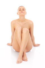 Young naked sitting woman