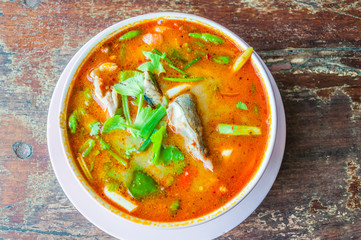 tom yum soup on grunge wooden table