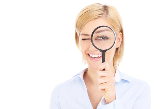 Businesswoman and magnifier