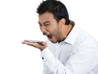 Angry man screaming on cellphone, white background