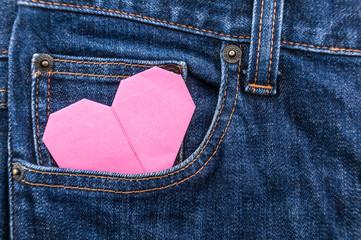 origami heart in blue jean pocket