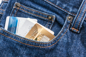credit card in blue jean pocket