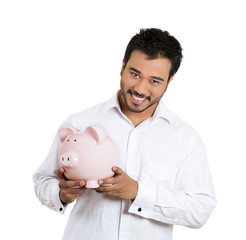 Happy savings. Excited man holding piggy bank, white background